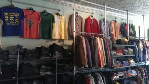 Nice rack of mens jeans, t-shirts and sweaters.