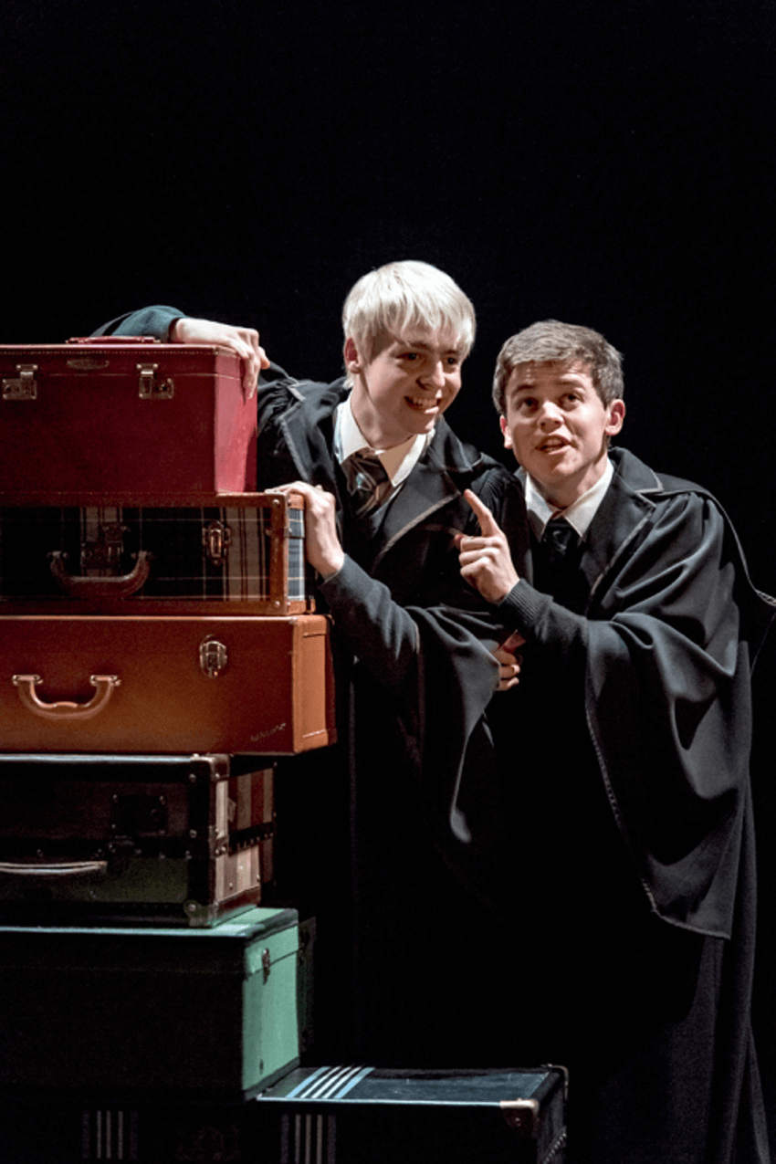 "Anthony Boyle as Scorpius Malfoy and Sam Clemmett as Albus Potter Suitcases in ""Harry Potter and the Cursed Child"", London's west end reviews"